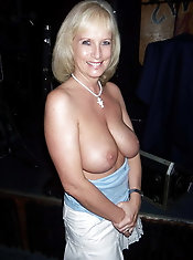 Chubby old businesswoman is posing seminaked